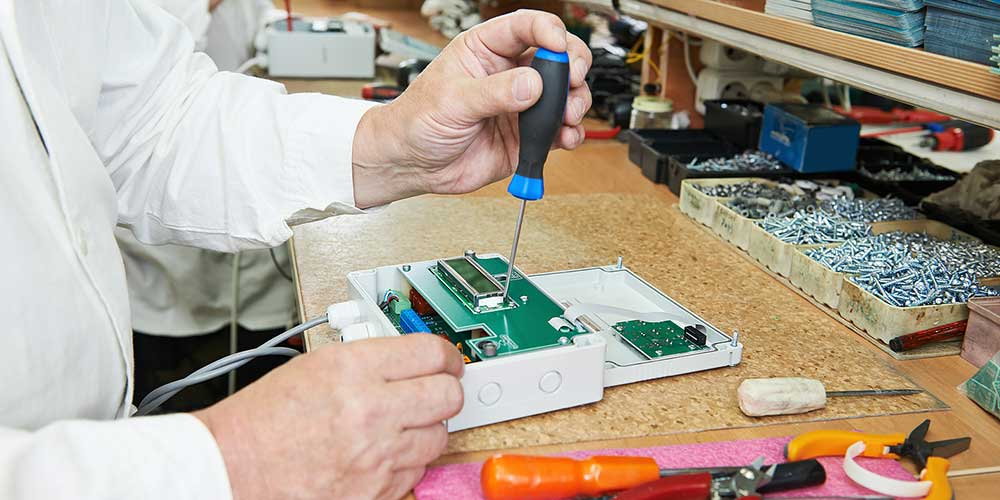 photo of man making a rf power supply